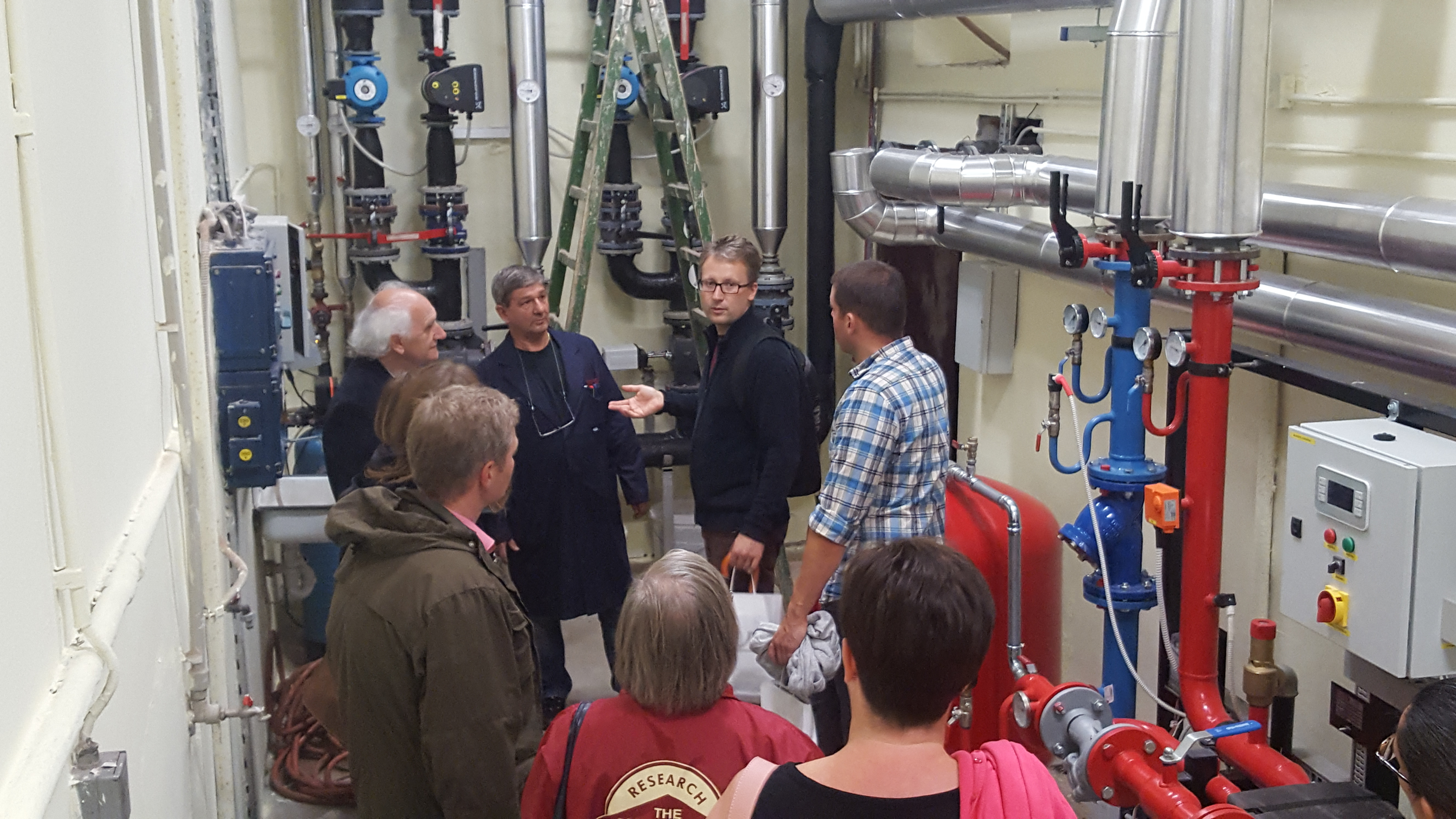 Group looking at heating systenm in Maribor