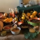 Buffet with apples, mandarins, pomegranates and different fruit spreads.