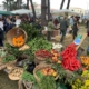 Vegetable display at farmers market in Piedimonte. You can see oranges, peppers, potatoes, artichokes and other vegetables and fruits.