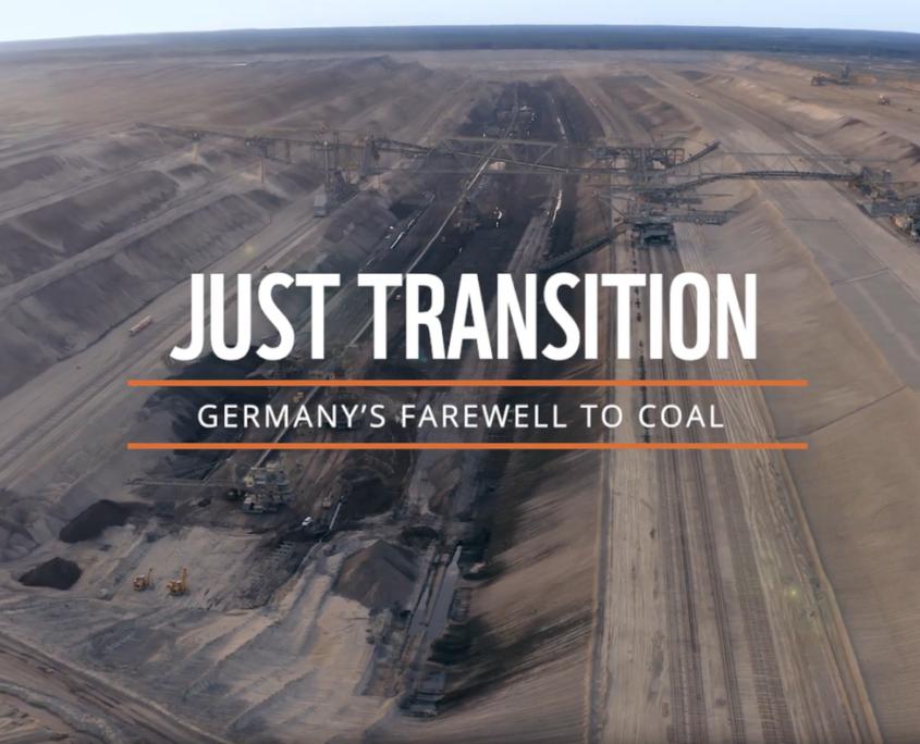 "Kohletagebau und Schriftzug ""Just Transition - Germany's farewell to coal"""