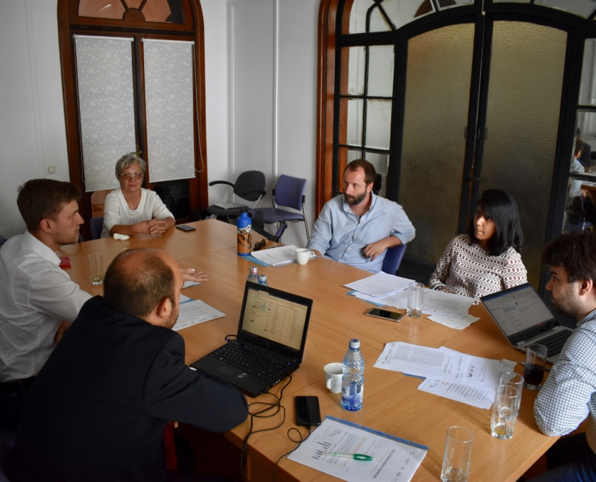 Conference table with people around