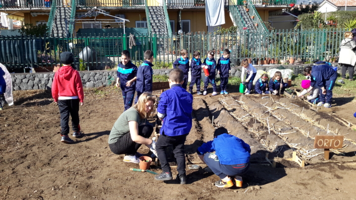 Children help build the seedbed