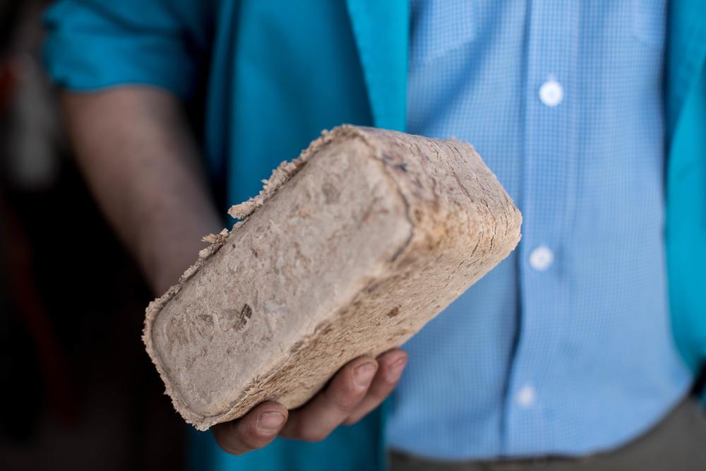 Eco-Briketts aus Abfallprodukten einer Fabrik werden als Feuerholz eingesetzt.