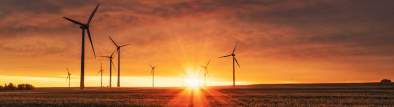 Wind turbines during sunset.