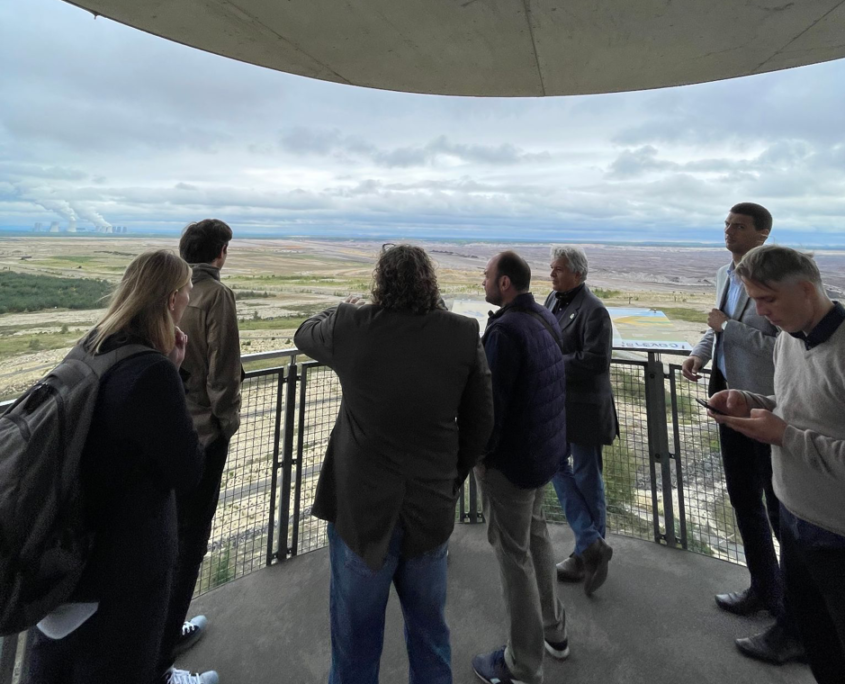 The participants visit an observation tower to view a coal power plant and a coal mine together with the Mayor of the town Weißwasser.